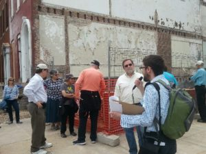 Baltimore Heritage tour group in front of demolished Freedom House